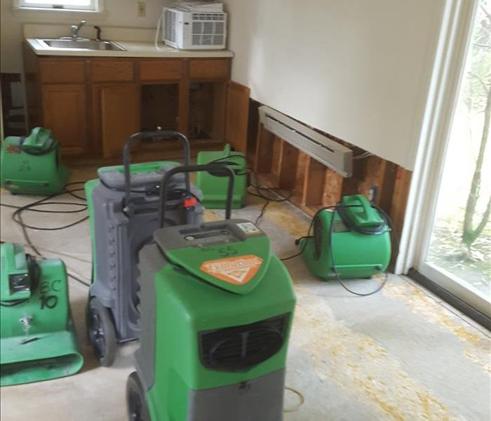 SERVPRO equipment in empty kitchen dinning room.