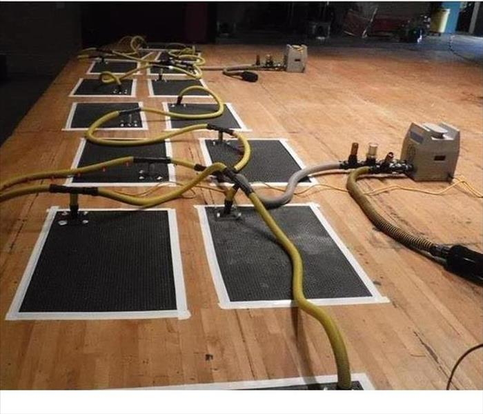 series of drying mats hooked with hoses