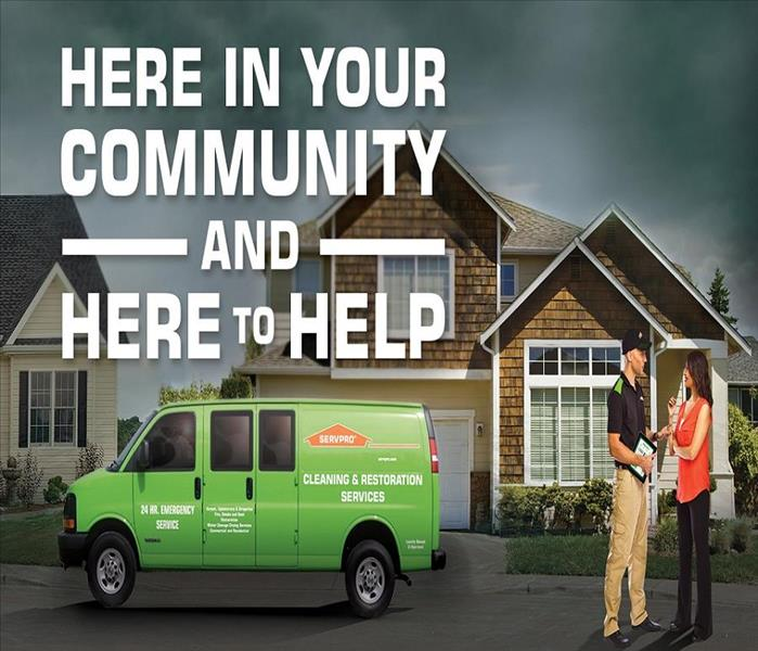 SERVPRO truck in front of house with the words Here To Help and SERVPRO Technician speaking to a customer.