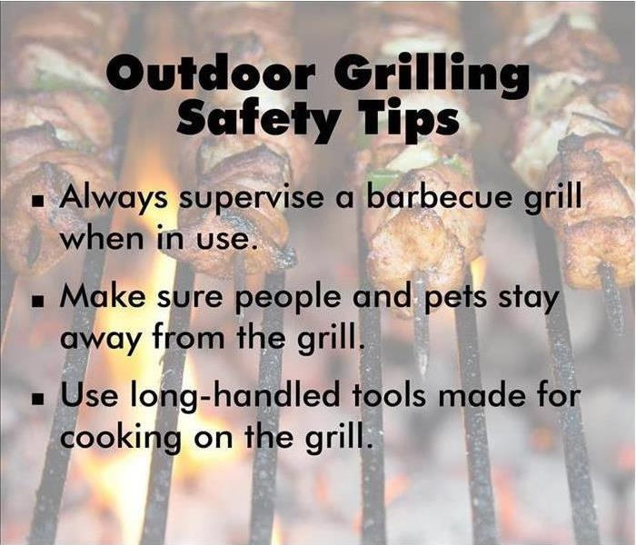 Picture of Barbecue Gill with safety tips printed on it.