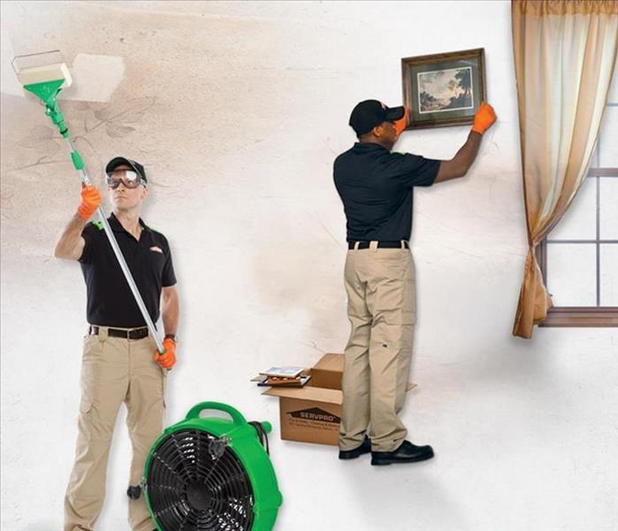 SERVPRO Technicians placing equipment and cleaning after a fire.