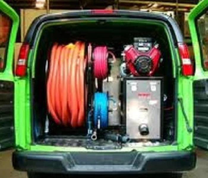 SERVPRO van with back doors open and filled with equipment.